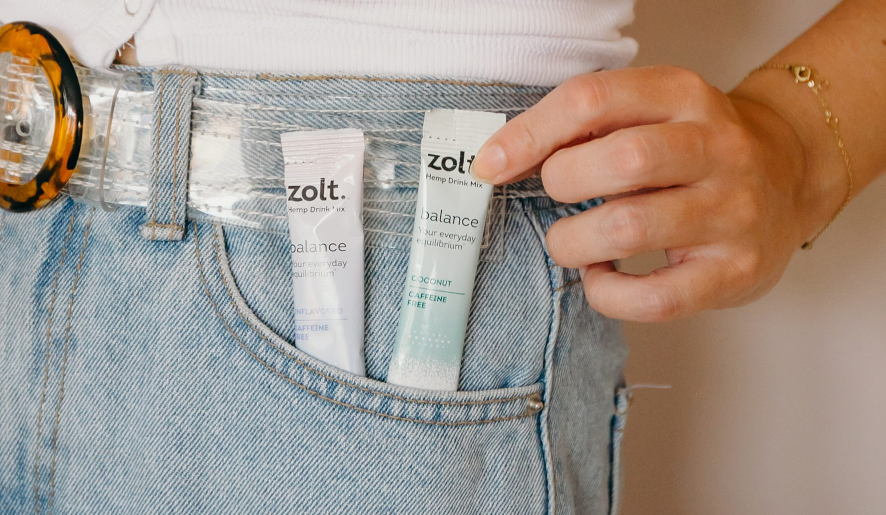 Woman grabbing Zolt Balance out of her pocket